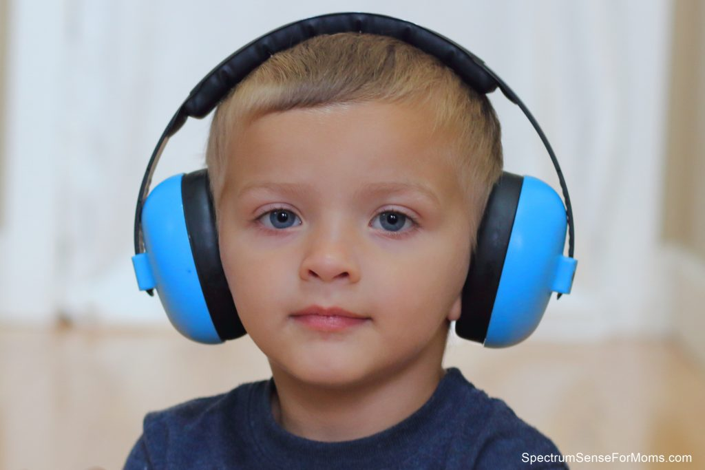 Use noise canceling headphones to help your child calm down during an autistic meltdown.
