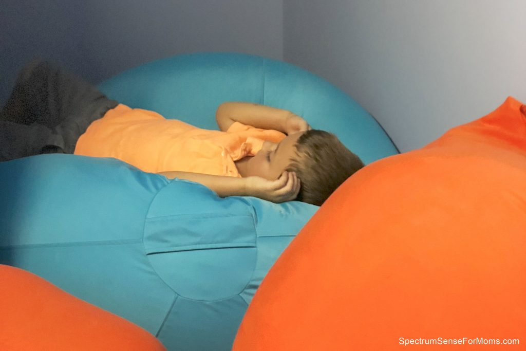 Keep your child safe during an autistic meltdown by moving them t a crash pad or sensory room.